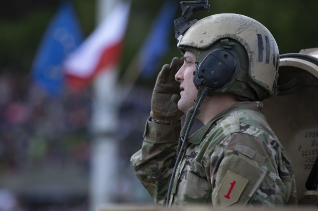 Maj. David Griffith, executive officer for 2nd Battalion, 34th Armored Regiment, 1st Infantry Division from Fort Riley, Kansas, atop an M1A2 Abrams Tank, renders a salute to the crowd during Poland's Constitution Day Parade in Warsaw, Poland, May 3, 2019. Approximately 30 Soldiers from 2nd Bn, 34th Armored Regt., 1st ABCT, 1st ID and four Soldiers from 5th Battalion, 7th Air Defense Artillery out of Baumholder, Germany, took part in Poland's Constitution Day Parade. (U.S. Army photo by Sgt. Thomas Mort)