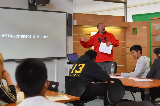 Jason Steadman, Advanced Placement Government and Politics teacher at Baumholder Middle High School, explains his course during AP Parent Student Night May 2. BMHS added five new AP courses for a total of 11 offered to students this fall.