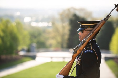 Sgt. Antonio Garcia Badge #655 lays a single rose at each of the crypts while conducting his last walk on the plaza at the Tomb Of The Unknown Soldier, Arlington National Cemetery, April 17, 2019.
