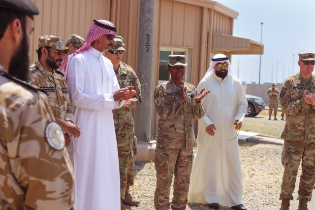 Attendees of the Khabari Crossing ribbon cutting ceremony listen as U.S. Army Col. Guy Reedy, 1st Theater Sustainment Command's Operational Command Post chief of staff, speaks on April 30, 2019. (U.S. Army photo by Sgt. Nahjier Williams)
