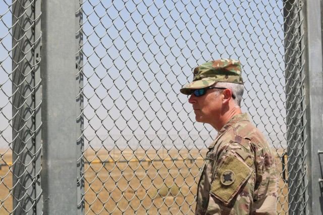 U.S. Army Col. Guy Reedy, 1st Theater Sustainment Command's Operational Command Post chief of staff gazes across the Khabari Crossing into Iraq following a ribbon cutting ceremony April 30, 2019. (U.S. Army photo by Sgt. Nahjier Williams)