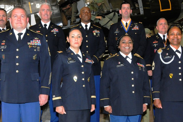 Retirees gather for a photograph prior to the April 26 Fort Rucker Quarterly Retirement Ceremony at the U.S. Army Aviation Museum. Back row: CW5 Lynwood Saville, CW4 Matthew Hertl, Sgt. 1st Class Gerald Joseph, CW4 Michael Becker and CW5 Michael Fiala. Front row: 1st Sgt. David Green, CW3 Betty Gonzalez, Staff Sgt. Denise De La Torre and 1st Sgt. Shlonda Calhoun.