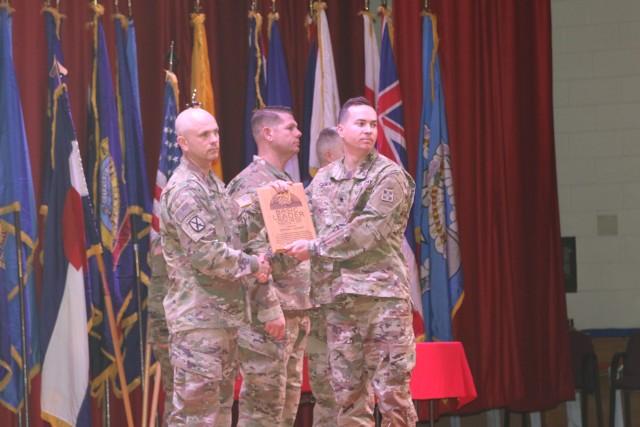 Spc. Matthew C. Culver receives the Distinguisded Honor Graduate award.