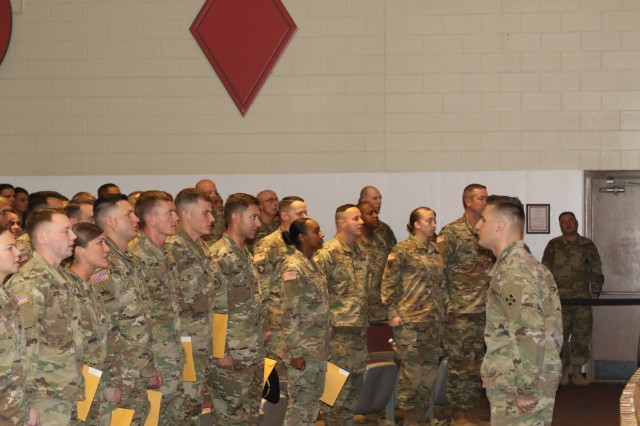Spc. Jesse R. Wolfe, A Troop, 2nd Squadron, 1st Cavalry Regiment, 1st Stryker Brigade Combat Team, 4th Infantry Division, the Distinguished Leader Award recipient, leads all NCOs in attendance, as they recite the Creed of the Non-Commissioned Officer.