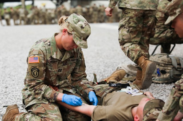 Capt. Lisa Kasper, an emergency room nurse assigned to 3rd Brigade Combat Team, 101st Airborne Division (Air Assault), inserts an intravenous needle into a patient during a training exercise at Fort Campbell, Ky., May 1.