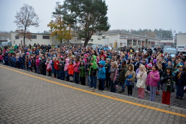 Resilient military students of Patch Elementary School, Panzer Kaserne, recite the Pledge of Allegiance before classes.
