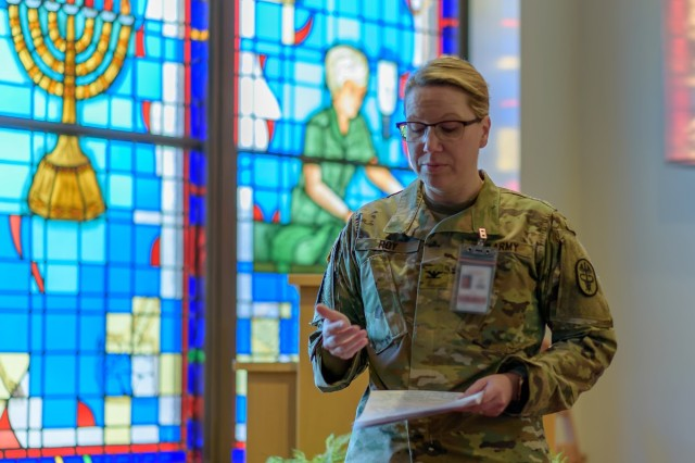 Col. Amy Roy, the deputy commander for nursing at Ireland Army Health Clinic, discusses the history of nurses' week, and of Florence Nightingale as she welcomes attendees at Monday's Blessing of the Hands ceremony.