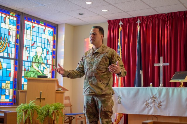 Maj. Johnathan Melendez, a chaplain for the Garrison Religious Support Office, Pastoral Care, gives a personal story about the importance of nurses in his life, as he gave thanks for the profession before the blessing.