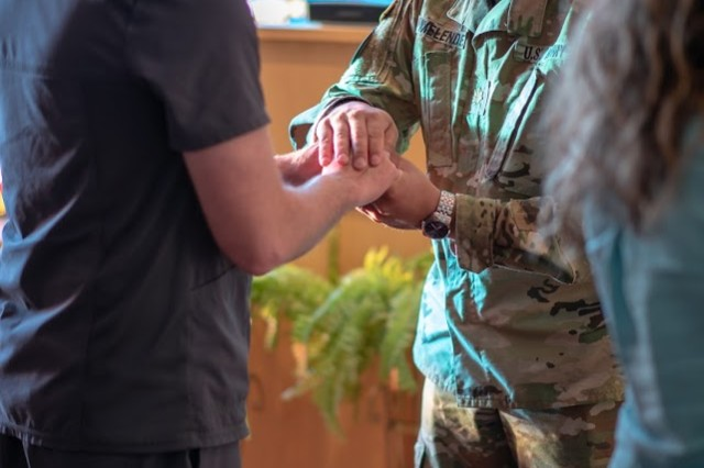 Maj. Johnathan Melendez, a chaplain for the Garrison Religious Support Office, pastoral care, gives a blessing at the May 6 Blessing of the Hands held at IRAHC. The ceremony was held in what was the chapel.