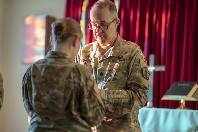 Lt. Col. Ralph Bieganek, the chaplain at Human Resources Command, assisted in the Blessing of the Hands ceremony May 6 at Ireland Army Health Clinic.