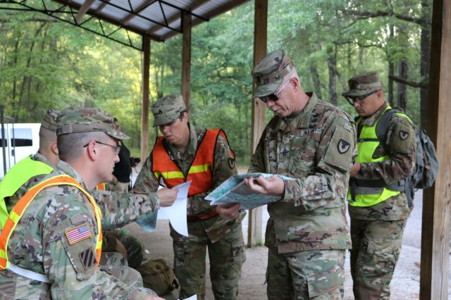 Aviation and Missile Command Sgt. Maj. Mike Dove reviews a terrain map with the five AMCOM Soldiers competing in the command's Best Warrior Competition at Fort Rucker, Alabama. The competition included a timed, three-hour land navigation course.