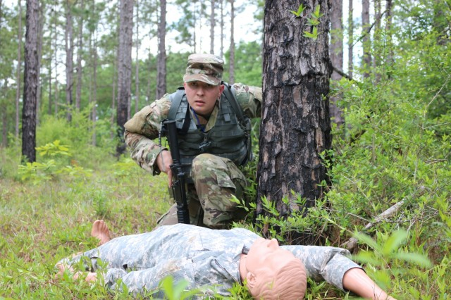 Spc. Sam Mitchell comes across a mock injured Soldier during a training scenario at the U.S. Army Aviation and Missile Command Best Warrior Competition at Fort Rucker, Alabama. Mitchell, stationed at Letterkenny Army Depot, Pennsylvania, was the winning Soldier and will compete at the Army Materiel Command competition in July.
