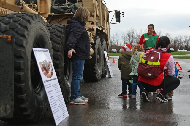 Soldiers of E Company, 41st Engineer Battalion, 2nd Brigade Combat Team, 10th Mountain Division, visited the Memorial Child Development Center during a static display for preschool children in honor of Month of the Military Child, April 26, 2019, at Fort Drum, New York. Mountain Sappers taught toddlers and kindergarteners about their equipment, and some of the military children opted to sit inside the two Heavy Expanded Mobility Tactical Trucks displayed outside the CDC. (U.S. Army photo by Staff Sgt. Paige Behringer)