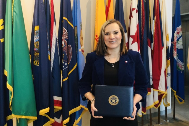 Jessica Dobbeleare, branch chief, ACC-RI, attended an April 2 award ceremony in Arlington, Virginia, in which she was presented an Office of the Secretary of Defense Group Achievement Award, for her contributions to the Advisory Panel on Streamlining and Codifying Acquisition Regulations, more commonly known as the Section 809 Panel. (Submitted photo)