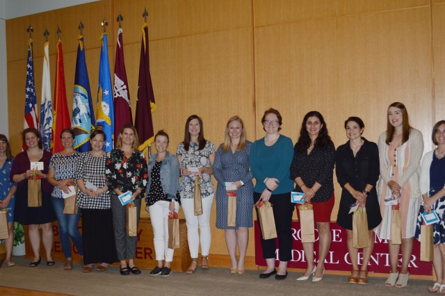 Several Brooke Army Medical Center Auxiliary board members pose for a photo after the annual Welfare Recognition Ceremony held May 6, 2019 in the auditorium. This year, the Auxiliary provided 25 grants totaling $28,000 to help support patient care at BAMC.