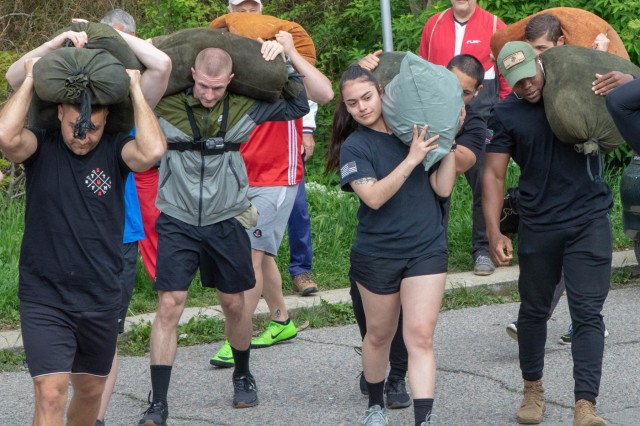 Staff Sgt. Michael Rowan, (second from left) and Spc. Jocelyn Zamora, both military policemen with the 313th Military Police Detachment, start their journey up a mountain alongside Spc. Chad Morgan (right), a military firefighter with the 524th Engineer Detachment, May 6, 2019, near Sliven, Bulgaria. Soldiers from the Novo Selo Training Area participated in the Haiduk Gathering, a competition that includes carrying a 95-pound jug of water up a mountain, rock throwing, knife throwing and wrestling. (U.S. Army photo by Spc. Ethan Valetski)