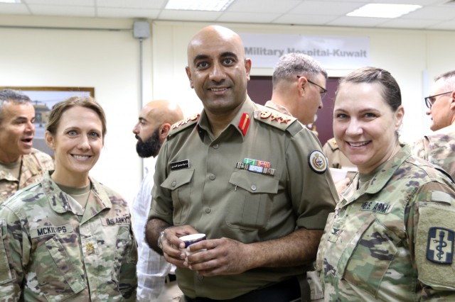 U.S. Army Maj. Kathy McKillups, 452d Combat Support Hospital, Col. Nawaf Al-Dosari, M.D., director of the North Military Medical Complex, and Col. Kathleen Clary, 452d CSH, stand together at Camp Arifjan, Kuwait, May 5, 2019. (U.S. Army National Guard photo by Sgt. Connie Jones)