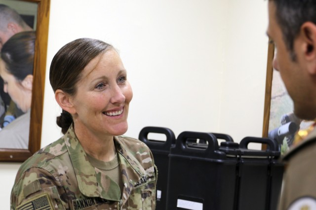 U.S. Army Col. Ellen Shannon-Ball, 452d Combat Support Hospital, speaks to Lt. Col. Mohammad Alghanem, M.D., director of the urology department at Jaber Al-Ahmed Armed Forces Hospital, at Camp Arifjan, Kuwait, May 5, 2019. (U.S. Army National Guard photo by Sgt. Connie Jones)