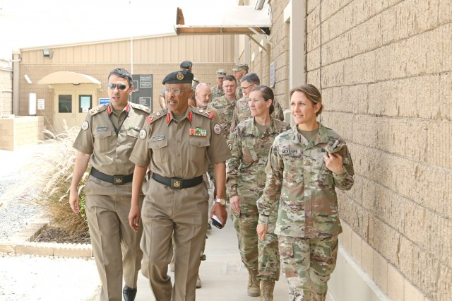Maj. Gen. Ibrahim Alameeri, director of Medical Health Authority, Kuwait Land Forces, walks with U.S. Army Maj. Kathy McKillups, 452d Combat Support Hospital, during a tour of the U.S. Military Hospital - Kuwait at Camp Arifjan, Kuwait, May 5, 2019. (U.S. Army National Guard photo by Sgt. Connie Jones)