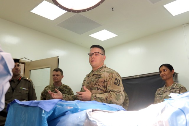 U.S. Army Sgt. Joseph Arledge, 452d Combat Support Hospital, explains operating room procedures at Camp Arifjan, Kuwait, May 5, 2019. (U.S. Army National Guard photo by Sgt. Connie Jones)