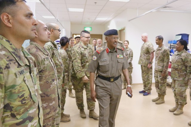 Maj. Gen. Ibrahim Alameeri, head of Medical Health Authority, Kuwait Land Forces, walks into the surgical suite of United States Military Hospital-Kuwait, at Camp Arifjan, Kuwait, May 5, 2019. (U.S. Army National Guard photo by Sgt. Connie Jones)