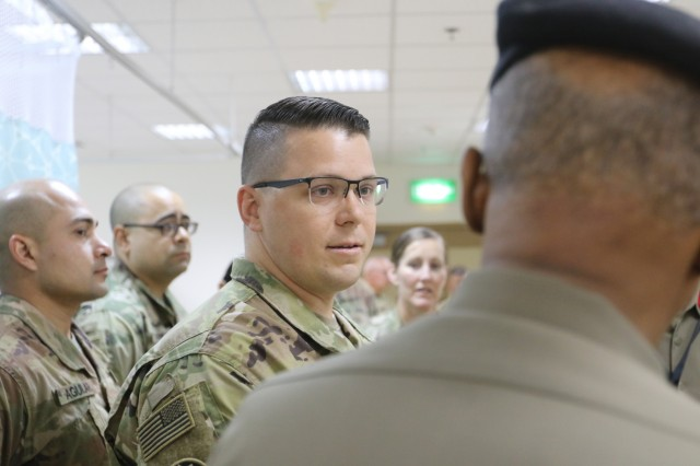 U.S. Army Sgt. Joseph Arledge, 452d Combat Support Hospital, speaks to Maj. Gen. Ibrahim Alameeri, director of Medical Health Authority, Kuwait Land Forces, at Camp Arifjan, Kuwait, May 5, 2019. (U.S. Army National Guard photo by Sgt. Connie Jones)