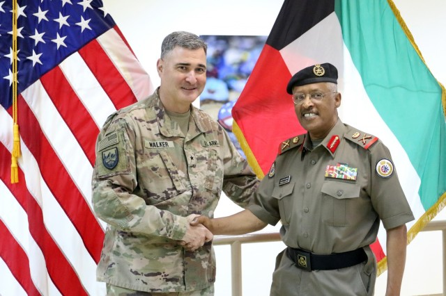 U.S. Army Brig. Gen. Clint E. Walker, commanding general of 184th Sustainment Command, stands with Maj. Gen. Ibrahim Alameeri, head of Medical Health Authority-Kuwait, at Camp Arifjan, Kuwait, May 5, 2019. (U.S. Army National Guard photo by Sgt. Connie Jones)