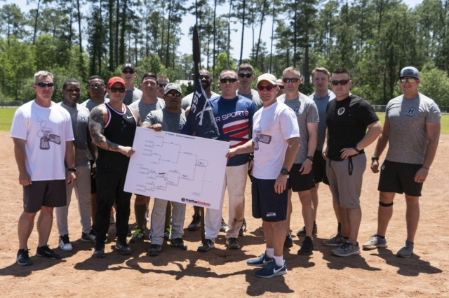 The Soldiers of the 2nd Battalion, 351st Infantry Regiment softball team stand with the 177th Armored Brigade command team, Col. Jack Vantress and Command Sgt. Maj. Robert Haynie, along with the brigade's spear at the conclusion of the Spearhead Softball Tournament, April 29th, 2019 at Camp Shelby, MS. The 177th Armored Brigade spear is awarded to whichever battalion wins a brigade-internal competition, and 2-351 'Eagle' Battalion had successfully defended the spear. (U.S. Army photo by Sgt. Roger Houghton/177th Armored Brigade Public Affairs)