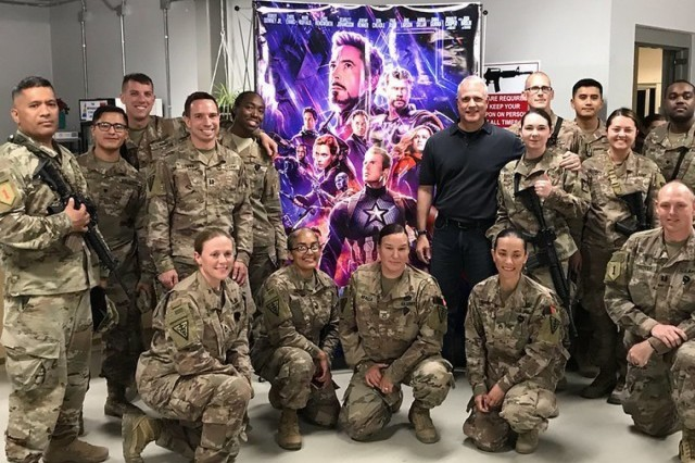 "Ken Caldwell, middle-right, senior vice president and general sales manager, The Walt Disney Studios, greeted service men and women when Disney and the Army & Air Force Exchange Service provided screenings of ""Avengers: Endgame"" in Afghanistan May 3 after a military spouse tweeted a Disney executive asking for a screening for deployed troops."