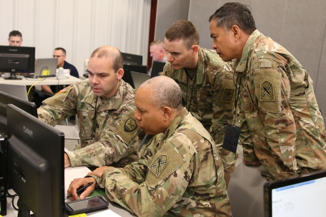 Virginia National Guard Soldiers assigned to the Fort Pickett-based Defensive Cyber Operations Element work with DCOE representatives from Delaware and New Mexico April 16, 2019, at Camp Atterbury, Indiana, during Cyber Shield 19. More than 800 National Guard personnel from 40 states and territories tested their skills in response to cyber incidents during the annual Cyber Shield exercise.along with civilians from state government agencies, federal agencies, industry partners and academia.