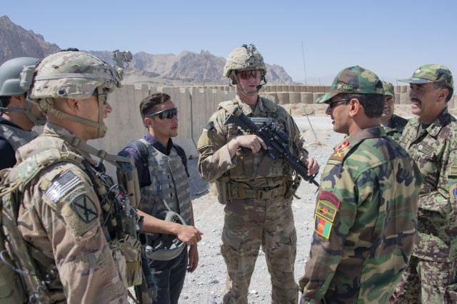 Sgt. 1st Class Jeremiah Velez, left, and Capt. David Zak, center, both advisors with the 1st Security Force Assistance Brigade's 3rd Squadron, speak with their Afghan National Army counterparts during a routine fly-to-advise mission at Forward Operating Base Altimur, Afghanistan, Sept. 19, 2018. 1st SFAB leaders speaking at a media roundtable in the Pentagon May 8, 2019, said the success of their mission proved the concept for this new type of training unit.