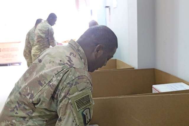 Sgt. Curtis Roach, 184th Sustainment Command, gathers mail from the post office at Camp Arifjan, Kuwait, April 29, 2019. (U.S. Army National Guard photo by Sgt. Connie Jones)