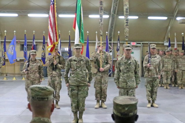 Col. Ellen Shannon-Ball, 452d Combat Support Hospital commander, and Command Sgt. Maj. Kristopher Orlowski, 452d CSH, stand at attention in front of the colors during the transfer of authority ceremony for United States Military Hospital - Kuwait at Camp Arifjan, Kuwait, May 6, 2019. (U.S. Army National Guard photo by Sgt. Connie Jones)