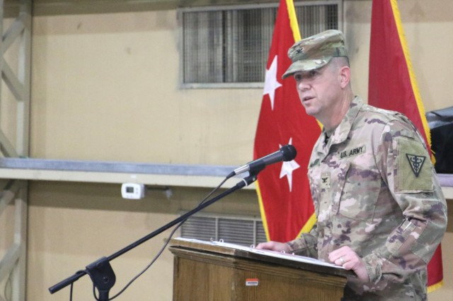Col. Jeffrey McCarter, 8th Medical Brigade commander, speaks to the audience during the transfer of authority ceremony for United States Military Hospital - Kuwait at Camp Arifjan, Kuwait, May 6, 2019. (U.S. Army National Guard photo by Sgt. Connie Jones)