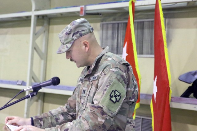 Capt. David McCarthy, 349th Combat Support Hospital chaplain, leads the benediction during the transfer of authority ceremony for United States Military Hospital-Kuwait at Camp Arifjan, Kuwait, May 6, 2019. (U.S. Army National Guard photo by Sgt. Connie Jones)