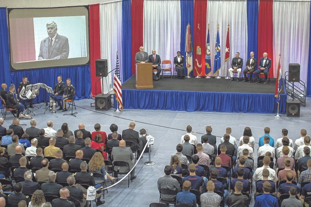 Missouri Governor Michael Parson offers words of encouragement to students being honored for choosing to serve in the military following graduation at the first Community Salute to Service held May 1 at Waynesville High School.