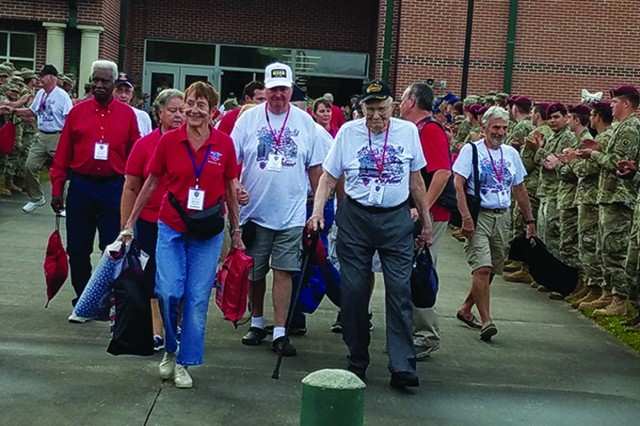 Soldiers line the walk way as veterans and their escorts begin their Honor Flight journey to Washington D.C. May 4 from Hunter Army Airfield. (Photo by Steve Hart, Hunter Army Airfield Public Affairs)