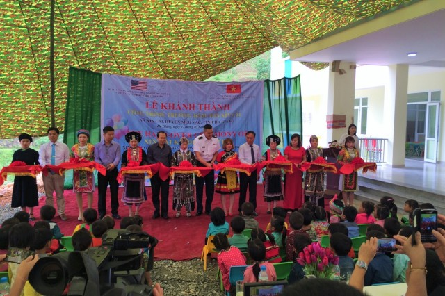 XIN CAI, Vietnam - (May 7, 2019) U.S. leaders officially turned over the keys to a brand new two-story kindergarten in Northwest Vietnam, Hagiang Province, near the border of China, during a ribbon-cutting ceremony May 7. The U.S. Army Corps of Engineers (USACE)-led project is a robust concrete masonry structure with onsite wastewater treatment. The 3,650 square-foot kindergarten has six classrooms and can hold up to 320 children. Chief of the Office of Defense Cooperation in Vietnam, Maj. Joshua Rodriguez (center), presided over the ceremony, highlighting the enduring partnership of the U.S. and Vietnam, as well as the strengthened alliance symbolized by the school's construction. (Photo credit: Courtesy of U.S. Embassy in Vietnam)