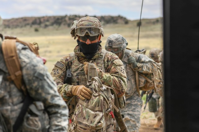 U.S. Army Spc. Louie A. Miranda, a cannon crewmember assigned to Bravo Battery, 2nd Battalion, 77th Field Artillery Regiment, 2nd Infantry Brigade Combat Team, 4th Infantry Division, prepares to board a UH-60 Black Hawk, May 2, 2019, during air assault training on Fort Carson, Colorado. (U.S. Army photo by Staff Sgt. Neysa Canfield)