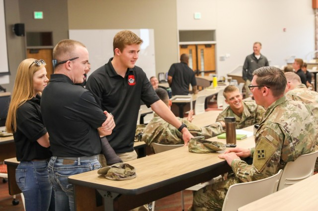 Cadets from the University of Colorado, Colorado Springs ask an officer from the 2nd Infantry Brigade Combat Team, 4th Infantry Division questions, April 25, 2019, after an officer brief at University Hall. Officers, from different branches of the Army, from the 2IBCT attended the brief to help cadets understand the opportunities of each branch. (U.S. Army photo by Staff Sgt. Neysa Canfield)