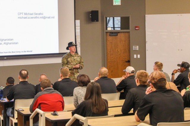 Capt. Michael A. Serafini, an armor officer assigned to 3rd Squadron, 61st Cavalry Regiment, 2nd Infantry Brigade Combat Team, 4th Infantry Division, address Cadets from the University of Colorado, Colorado Springs, April 25, 2019, during an officer brief at University Hall. Officers, from different branches of the Army, from the 2IBCT attended the brief to help cadets understand the opportunities of each branch. (U.S. Army photo by Staff Sgt. Neysa Canfield)