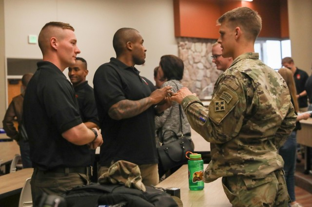 First Lt. Tyler Rettke, an infantry officer assigned to 1st Battalion, 41st Infantry Regiment, 2nd Infantry Brigade Combat Team, 4th Infantry Division, talks to Cadets from the University of Colorado, Colorado Springs, April 25, 2019, after an officer brief at University Hall. Officers, from different branches of the Army, from the 2IBCT attended the brief to help cadets understand the opportunities of each branch. (U.S. Army photo by Staff Sgt. Neysa Canfield)