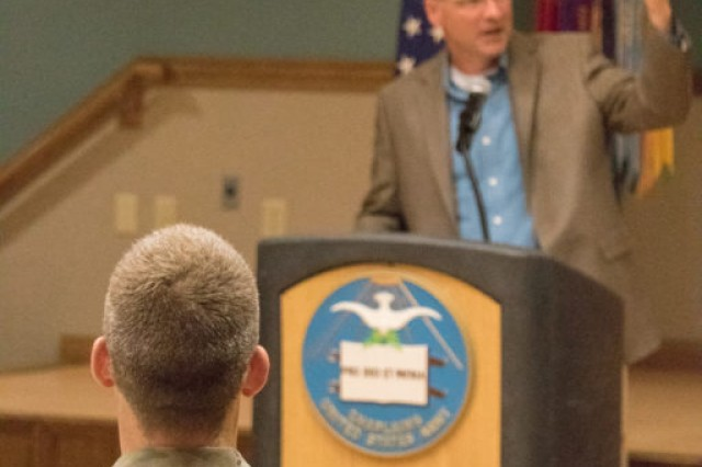 Gauthier gestures during his speech while Chaplain (Col.) David Bowlus listens.