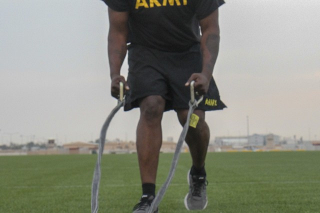 Sergeant 1st Class Jarod Gatson, communications noncommissioned officer in charge, Headquarters and Headquarters Company, 1st Battalion, 114th Infantry Regiment, prepares for the drag portion of the sprint-drag-carry Army Combat Fitness Test event during a familiarization training at Camp As Sayliyah, Qatar, May 4, 2019.