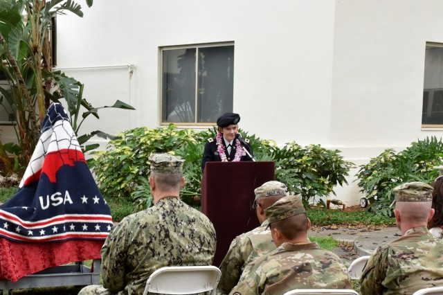 """Col. Mary V. Krueger, commander, Tripler Army Medical Center, provides remarks during the Nurses Week Opening Ceremony to honor all nurses; and to unveil """"Pualani,"""" a bronze statue of a Vietnam-era nurse formerly named, """"Nurse,"""" also referred to as, """"The Lady,"""" at Tripler's Regimental Park, May 6."""