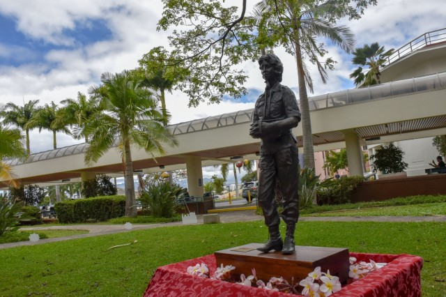"""Tripler Army Medical Center kicked-off National Nurses Week with an opening ceremony to honor all nurses; and to also unveil """"Pualani,"""" a bronze statue of a Vietnam-era nurse formerly named, """"Nurse,"""" also referred to as, """"The Lady,"""" at Tripler's Regimental Park, Honolulu, Hawaii, May 6."""