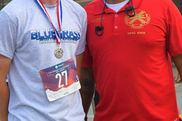 Shawn Baker, with the Blue Grass Army Challenge with Fort Knox Garrison Command Sgt. Maj. Garrick Griffin. Baker was the first runner from the Blue Grass Army Challenge to cross the finish line.