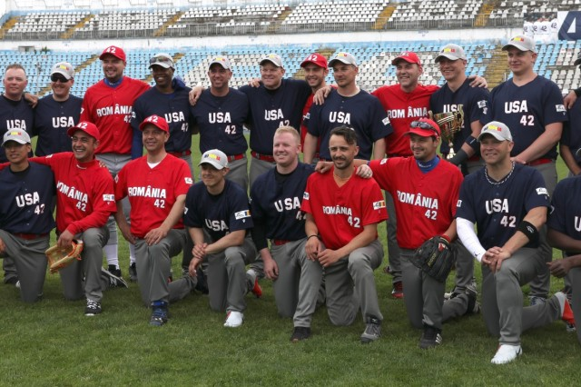 U.S. Army Soldiers pose for a team photo after participating in the third annual Jackie Robinson Trophy baseball game at Farul Stadium, Constanta, May 11, 2019. This yearly face off between the U.S. and Romania builds trust with the Romanian community and allows them to enhance this bond through shared culture and experiences. (U.S. Army photo by Pfc. Andrew Wash)