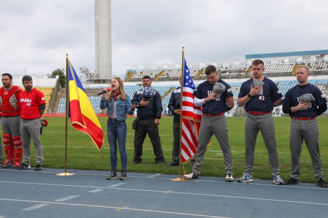 A Romanian girl sings the American National Anthem before the third annual Jackie Robinson Trophy baseball game between U.S. Army Soldiers and Romanian National Baseball Team at Farul Stadium, Constanta, May 11, 2019. The game was a way to support cohesion between the U.S. Army and the Romanian community. (U.S. Army photo by Pfc. Andrew Wash)