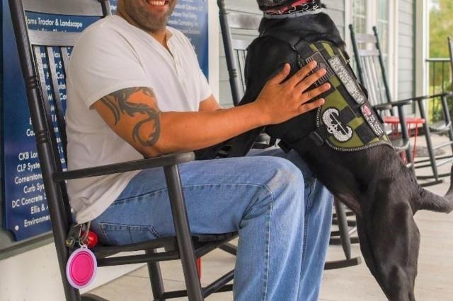 Retired Staff Sgt. Carlos Cruz and his service dog Hannah, Jan. 5, 2018.
